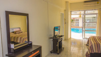 Fully furnished apartment rental with Flat Screen TV, Dressing Table, Closet / Wardrobe, Dining Table and Sofa etc.