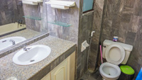 Two bathrooms with bathtubs and sink in Nirun condo for rentals.
